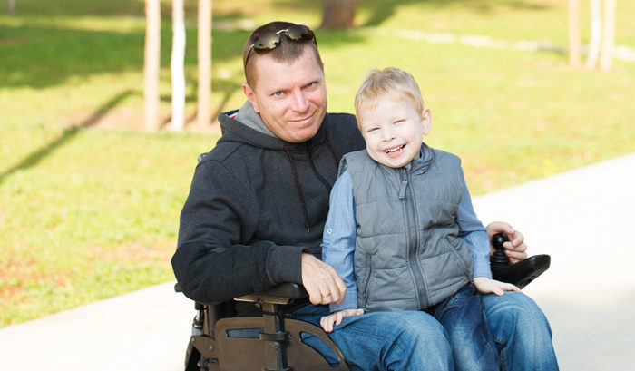 man with long-term disability insurance and his son at a park